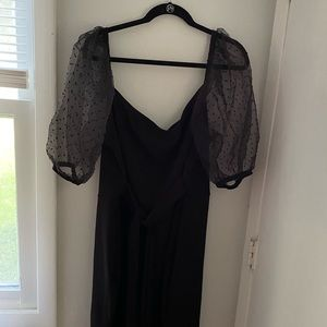 Black mini body con dress with organza sleeves!